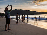 27 DECEMBER 2014 - PATONG, PHUKET, THAILAND: Tourists on Patong Beach at sunset. Patong Beach is the largest beach on Phuket island. It's popular with tourists from Australia and Europe. In recent years it has become a leading destination for Russian tourists.    PHOTO BY JACK KURTZ