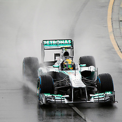 F1 Australian Grand Prix 16 March 2013 Qualifying Session 1.Qualifying Session 1. Lewis Hamilton Mercedes AMG Petronas flys around a wet Albert Park circuit during qualifying..(c) MILOS LEKOVIC | StockPix.eu