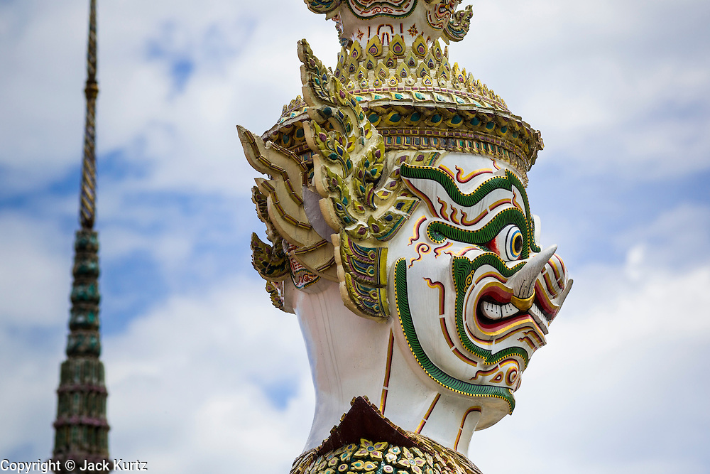 05 MAY 2013 - BANGKOK, THAILAND:   A Hanuman statue guards an entrance to the Grand Palace. The Grand Palace is a complex of buildings at the heart of Bangkok. The palace has been the official residence of the Kings of Siam (and later Thailand) since 1782. The king, his court and his royal government were based on the grounds of the palace until 1925. The present monarch, King Bhumibol Adulyadej (Rama IX), currently resides at Chitralada Palace, but the Grand Palace is still used for official events. Several royal ceremonies and state functions are held within the walls of the palace every year. Construction of the palace began on 6 May 1782, at the order of King Buddha Yodfa Chulaloke (Rama I), the founder of the Chakri Dynasty, when he moved the capital city from Thonburi to Bangkok. Throughout successive reigns, many new buildings and structures were added, especially during the reign of King Chulalongkorn (Rama V).     PHOTO BY JACK KURTZ