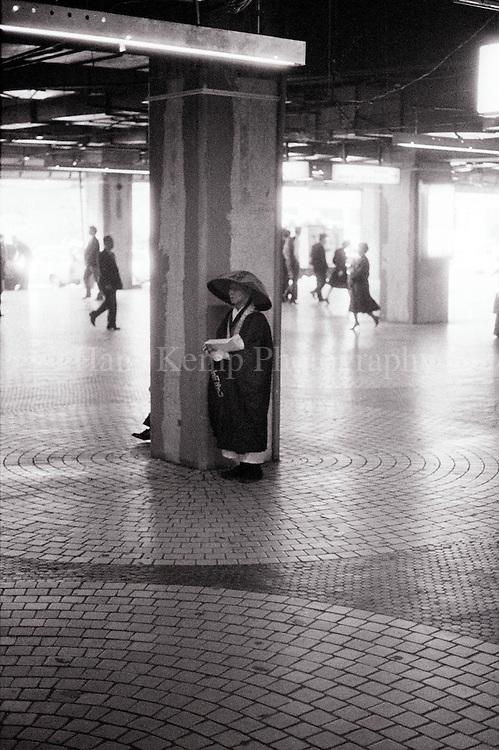 A Buddhist monk collecting alms at Tokyo Shinjuku Station, 1986