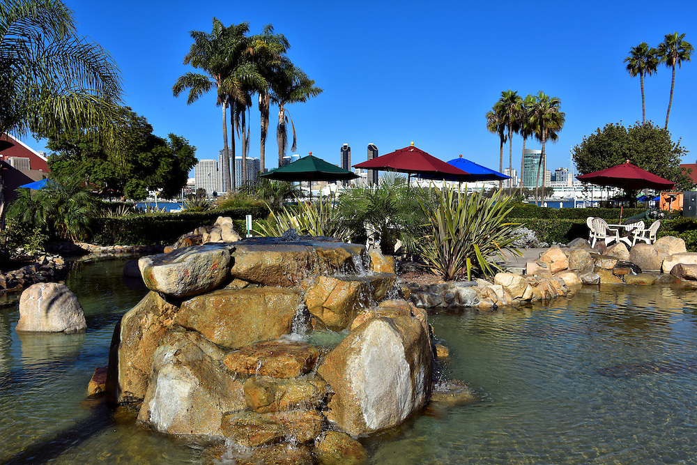 Waterfalls, Pond and Beach Umbrellas in Coronado, California <br />