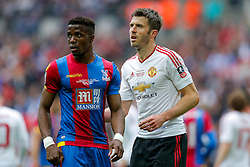 Michael Carrick of Manchester United marks Wilfried Zaha of Crystal Palace - Mandatory byline: Rogan Thomson/JMP - 21/05/2016 - FOOTBALL - Wembley Stadium - London, England - Crystal Palace v Manchester United - FA Cup Final.