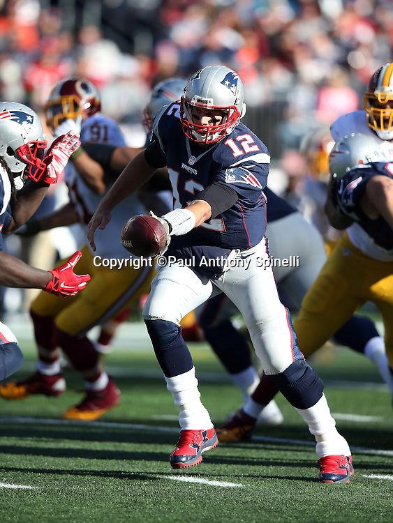 New England Patriots quarterback Tom Brady (12) hands off the ball on a running play during the 2015 week 9 regular season NFL football game against the Washington Redskins on Sunday, Nov. 8, 2015 in Foxborough, Mass. The Patriots won the game 27-10. (©Paul Anthony Spinelli)