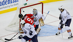 Nov 9, 2008; Newark, NJ, USA; New Jersey Devils left wing Zach Parise (9) tips a shot by Edmonton Oilers goalie Jeff Drouin-Deslauriers (38) during the third period at the Prudential Center. The Oilers defeated the Devils 2-1.