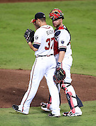 ATLANTA, GA - SEPTEMBER 02:  Catcher Brian McCann #16 of the Atlanta Braves walks back to the mound with pitcher Brandon Beachy #37 during a break in the action during the game against the Los Angeles Dodgers at Turner Field on September 2, 2011 in Atlanta, Georgia.  (Photo by Mike Zarrilli/Getty Images)