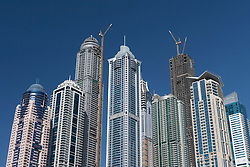 View of modern high-rise apartment buildings under construction in Marina at New Dubai in United Arab Emirates