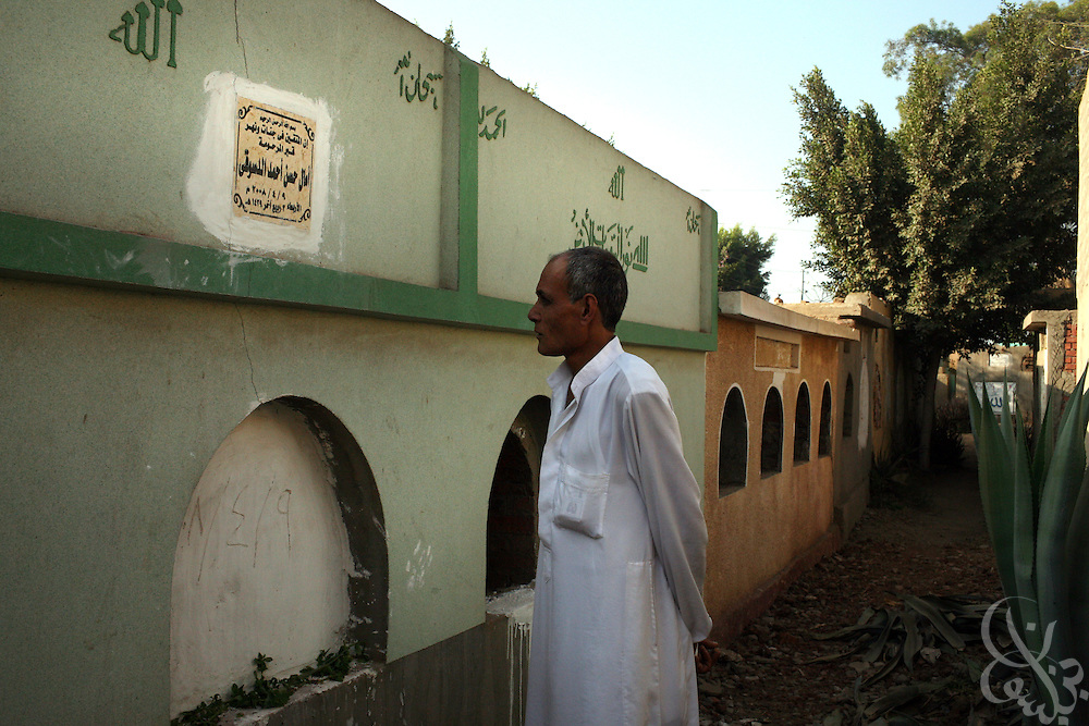 Hamid  Khalil, 46, visits the grave of his late wife, Amal al Dusouqi, 43, in their apartment in Mahalet Damana, 135 kilometers north of Cairo. Khalil's wife died April 9, 2008, after being trampled in a subsidized bread line stampede near her home. Rising food prices have become a increasing  crisis for Egypt's poor over the past several months.