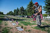 Putting out U.S. flags at the Santa Fe National Cemetery
