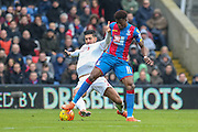 Wilfried Zaha (11) of Crystal Palace tackles Liverpool midfielder Emre Can (23)  during the Barclays Premier League match between Crystal Palace and Liverpool at Selhurst Park, London, England on 6 March 2016. Photo by Phil Duncan.