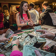WASHINGTON,DC - MAR2 0: Jessie Edington looks on as money is counted at aSweet Briar College pop-up fundraiser at Mission in Dupont Circle, to save the womens' college in Virginia which will close if it can't raise $250M, March 20, 2015. (Photo by Evelyn Hockstein/For The Washington Post)