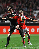 20100401: LISBON, PORTUGAL - SL Benfica vs Liverpool: Europa League 2009/2010 - Quarter-Finals - 1st leg. In picture: Fabio Coentrao (Benfica) and Fernando Torres (Liverpool). PHOTO: Alvaro Isidoro/CITYFILES