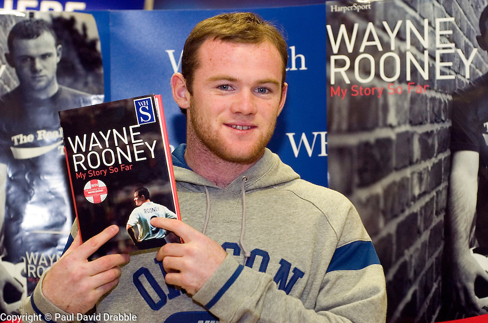 """Wayne Rooney Signs Coppies of his autobiography """"My Story So Far"""" at WH Smiths in Meadowhall Sheffield. 9 November 2006.Copyright Paul David Drabble."""