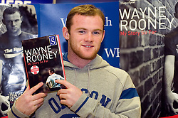 "Wayne Rooney Signs Coppies of his autobiography ""My Story So Far"" at WH Smiths in Meadowhall Sheffield. 9 November 2006.Copyright Paul David Drabble."
