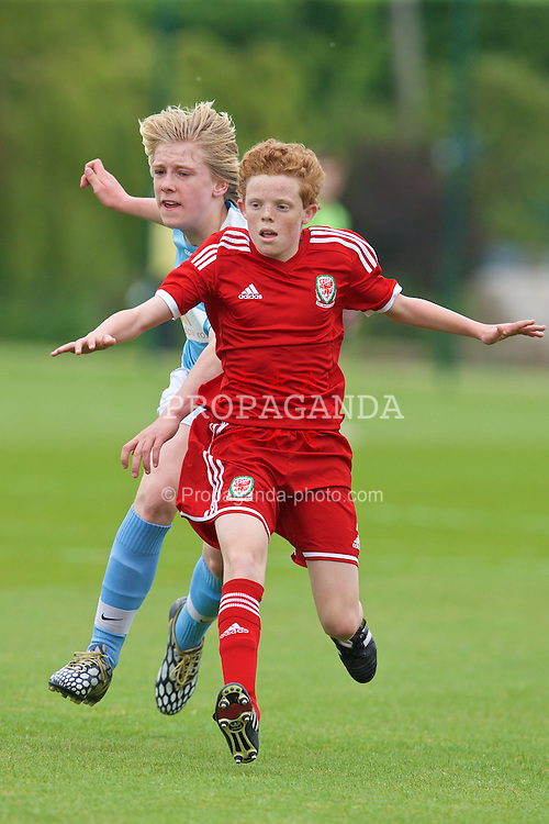 NEWPORT, WALES - Wednesday, May 27, 2015: South WPL Academy Boys' Ioan Evans and Regional Development Boys' Lewis Clutton during the Welsh Football Trust Cymru Cup 2015 at Dragon Park. (Pic by David Rawcliffe/Propaganda)