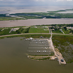 A aerial view of Joshua's Marina in the town of Buras, Louisiana, U.S., on Monday, July 26, 2010. Buras is the home to many fisherman in southern Plaquemines Parish and is still recovering from the impact of Hurricane Katrina, now residents are dealing with the closure of their area fishing grounds. Photographer: Derick E. Hingle