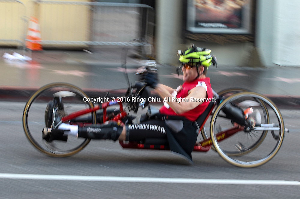 A wheelchair runner make his way along Hollywood Boulevard during the 31st Los Angeles Marathon in Los Angeles, Sunday, Feb. 14, 2016. The 26.2-mile marathon started at Dodger Stadium and finished at Santa Monica.  (Photo by Ringo Chiu/PHOTOFORMULA.com)<br /> <br /> Usage Notes: This content is intended for editorial use only. For other uses, additional clearances may be required.