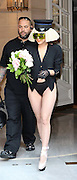 10.SEPTEMBER.2009 - PARIS<br /> <br /> US POP STAR LADY GAGA LEAVING HER HOTEL IN PARIS CLUTCHING A BOUQUET OF FLOWERS THEN THROWING THEM IN THE AIR FOR HER FANS TO CATCH.<br /> <br /> BYLINE: EDBIMAGEARCHIVE.COM<br /> <br /> *THIS IMAGE IS STRICTLY FOR UK NEWSPAPER & MAGAZINES ONLY*<br /> *FOR WORLDWIDE SALES & WEB USE PLEASE CONTACT EDBIMAGEARCHIVE - 0208 954 5968*