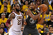 June 3, 2018; Oakland, CA, USA; Golden State Warriors forward Kevin Durant (35) handles the ball against Cleveland Cavaliers forward LeBron James (23) during the second quarter in game two of the 2018 NBA Finals at Oracle Arena.