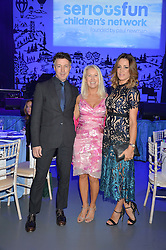 Left to right, actor AIDAN GILLEN, CLEA NEWMAN daughter of the late actor Paul Newman founder of the SeriousFun Children's network and NATALIE PINKHAM at the SeriousFun Children's Network London Gala held at The Roundhouse, Chalk Farm Road, London on 3rd November 2016.