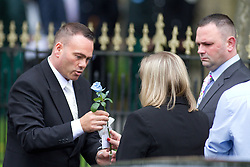 © Licensed to London News Pictures. 19/07/2012. Oldham , UK .A  funeral directors lifts a blue rose from Jamie Heaton's coffin and passes it to Michelle and Ken Heaton, aperents of Jamie Heaton. The funeral of 2 year old Jamie Heaton , who was killed in a blast in his home on 26/06/2012 . Photo credit : Joel Goodman/LNP