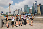 Young women view the skyline of Lujiazui Pudong Shanghai, China