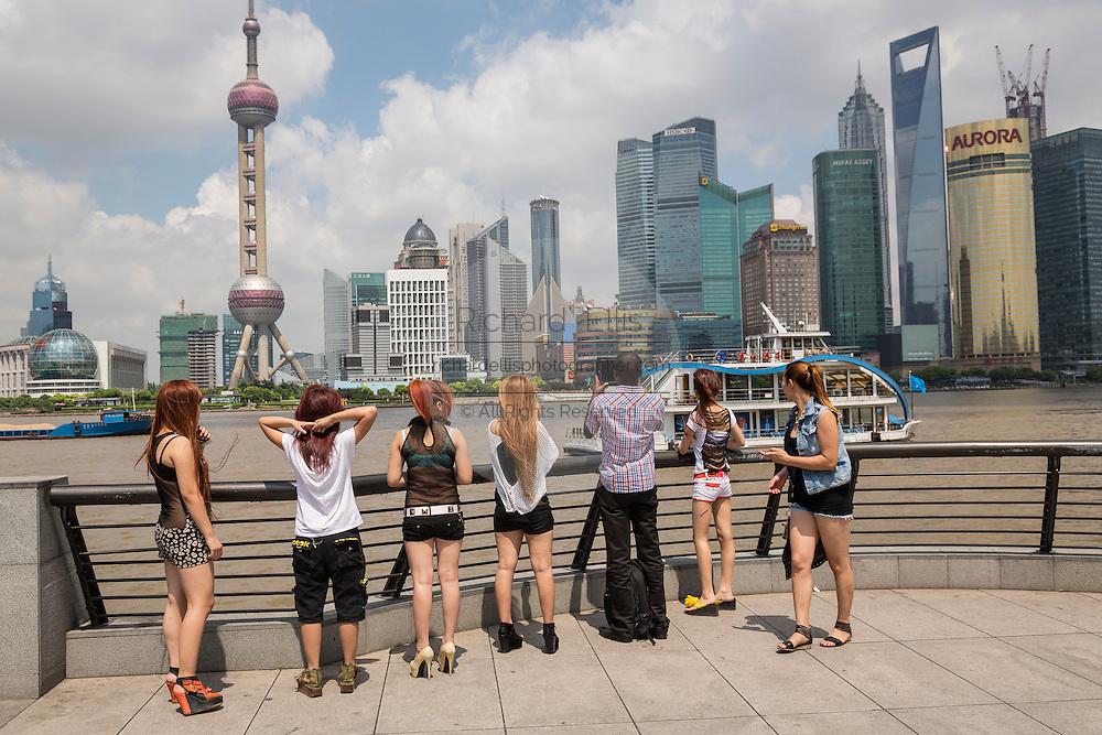 Young women view the skyline of Lujiazui Pudong Shanghai, China