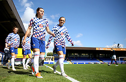 Chelsea's Ramona Bachmann (left) and Erin Cuthbert walk out on to the pitch for the pre-match warm up prior to the FA Women's Super League match at Kingsmeadow, London.