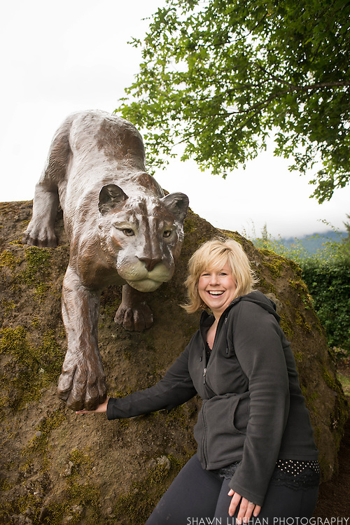 Heather Soderberg and her husband Rich Greene poses with her sculpture of a cougar in Cascade Locks, Oregon.