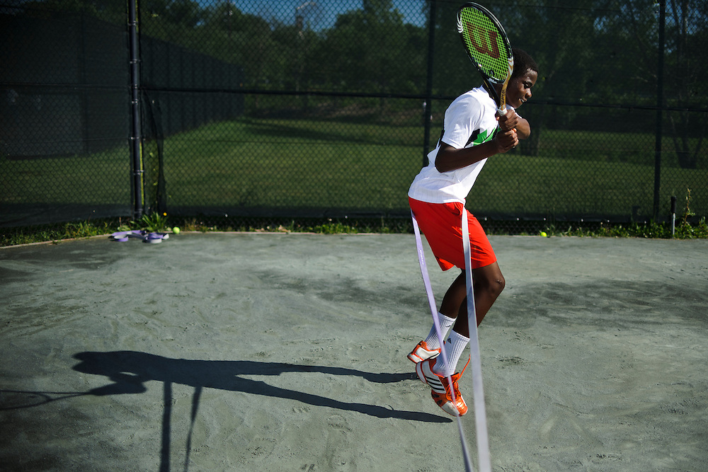 photo by Matt Roth.Friday, May 11, 2012.Assignment ID: 30125820A..Francis Tiafoe, the top-ranked 14-year-old tennis player in the country, trains during an intense strength and conditioning session at the Tennis Center at College Park in Maryland, Friday, May 11, 2012...His father immigrated from Sierra Leone in 1996. Francis's father, Constant lived where he worked at the Tennis Center at College Park, where Francis and his twin brother Franklin would occasionally sleep. Misha Kouznetsov, a tennis pro at the Center saw potential in Francis and has been training the twins since they were eight. Constant and his family have since moved into an apartment five minutes away, and the boys train and go to school full-time at the Center.