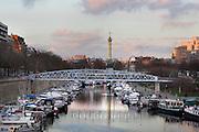 Port de l'Arsenal, boat basin connecting Canal Saint Martin to the Seine river, Colonne de Juillet (July Column) visible in the background, La Bastille, Paris, France. Picture by Manuel Cohen
