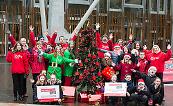 Campaigners from Shelter Scotland raise awareness of their campaign &quot;Homelessness - Far From Fixed&quot; outside the Scottish Parliament in Edinburgh. They are joined by carol singers from Corstorphine Primary School, a Christmas tree and a giant snakes and ladders board game - Chance Not Choice - which illustrates how life chances affect people's ability to keep a roof over their head.<br /> <br /> Pictured:
