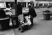 New york City, Sixth Avenue, The Avenue of the Americas..., a homeless man looks for cans to recycle to get enough money to eat.
