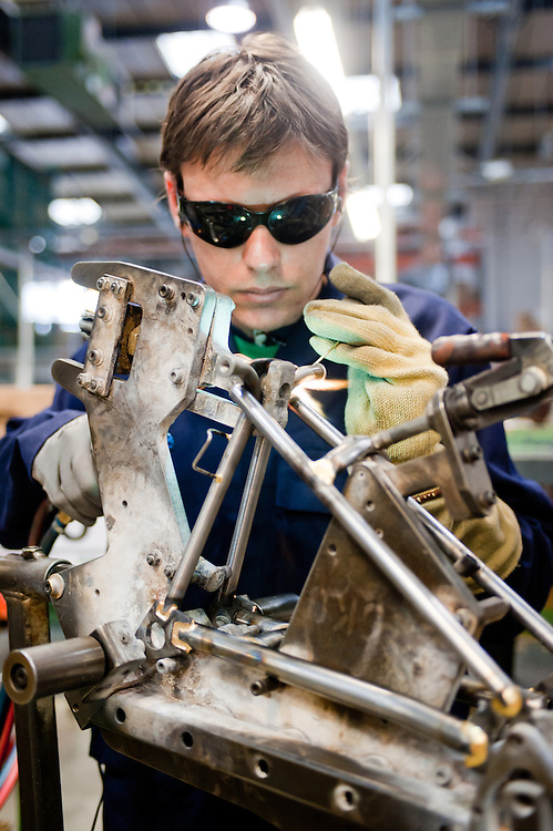 London, UK - 29 January 2013: a workman brazes components of a  folding bike in the Brompton Bicycle factory in South West London. The company was founded in 1976 by Andrew Ritchie and is one of only two major frame manufacturers still based in the UK. Today, Bromptons are sold in 42 export markets.