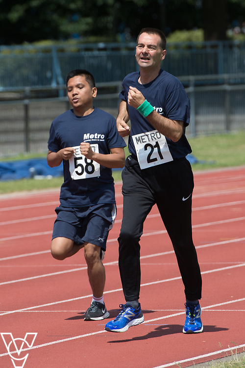 Metro Blind Sport's 2017 Athletics Open held at Mile End Stadium.  800m. Oliver Cousins, left, and Mike Winstone<br /> <br /> Picture: Chris Vaughan Photography for Metro Blind Sport<br /> Date: June 17, 2017