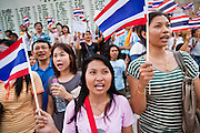 "Apr. 18, 2010 - Bangkok, Thailand: Thais sing their national anthem at the end of a Pink Shirt peace rally in Bangkok Sunday. Thousands of so called ""Pink Shirts"" jammed the area around Victory Monument in Bangkok to show support the Thai Monarch, King Bhumibol Adulyadej, and against the Red Shirts, who are demonstrating just a few kilometres away in the Ratchaprasong area. The Pink Shirts claim to not support either of the other political factions who wear colors - the Red Shirts, who support deposed Prime Minister Thaksin Shinawatra and their opponents the Yellow Shirts, who are against Thaksin.   Photo By Jack Kurtz"