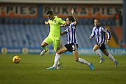 Brighton striker, Sam Baldock (9) and Sheffield Wednesday midfielder Sam Hutchinson (4) during the Sky Bet Championship match between Sheffield Wednesday and Brighton and Hove Albion at Hillsborough, Sheffield, England on 3 November 2015.