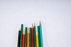 Colored pencils arranged in various formations