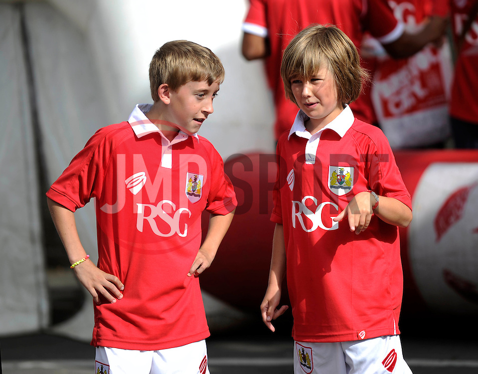 Two Bristol City fans wear the new 14/15 home shirt - Photo mandatory by-line: Dougie Allward/JMP - Mobile: 07966 386802 11/07/2014 - SPORT - FOOTBALL - Bristol - Ashton Gate - Bristol City Fan Friday