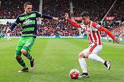 Bojan Krkic of Stoke City crosses ahead of Gylfi Sigurdsson of Swansea City  - Mandatory by-line: Matt McNulty/JMP - 02/04/2016 - FOOTBALL - Britannia Stadium - Stoke-on-Trent, England - Stoke City v Swansea City - Barclays Premier League