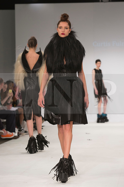 © Licensed to London News Pictures. 30/05/2015. London, UK. A model walks the runway during the Northbrook College Sussex fashion show at Graduate Fashion Week 2015 wearing the collection of graduate student Curtis Fulman. Graduate Fashion Week takes place from 30 May to 2 June 2015 at the Old Truman Brewery, Brick Lane. Photo credit : Bettina Strenske/LNP