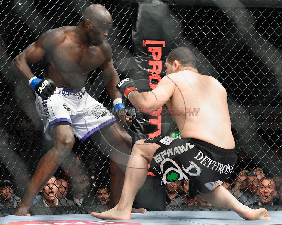 "COLOGNE, GERMANY, JUNE 13, 2009: Cain Velasquez and Cheick Kongo during ""UFC 99: The Comeback"" inside LanXess Arena, Cologne"