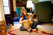 Angela Behnken's husband John, 27, died suddenly from the H1N1, swine flu, in November. She said she spends more time with his friends now so she can catch some of his sense of humor that she misses so and laugh again. She sits with her dog Rufus after work in her home in Johns Creek, Georgia April 22, 2010.