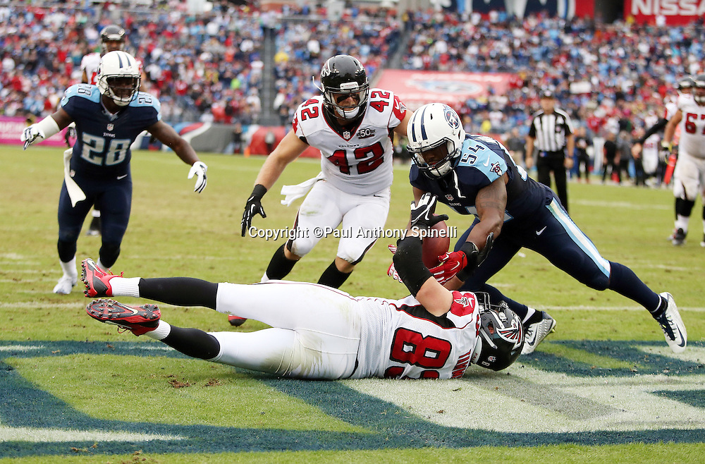 Atlanta Falcons tight end Jacob Tamme (83) tries unsuccessfully to reach back and catch a fourth down pass intercepted in the end zone by Tennessee Titans linebacker Avery Williamson (54) during the 2015 week 7 regular season NFL football game against the Tennessee Titans on Sunday, Oct. 25, 2015 in Nashville, Tenn. The Falcons won the game 10-7. (©Paul Anthony Spinelli)