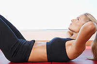 Woman Doing Sit-Ups close up side view