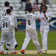 Fidel Edwards (Hampshire CCC) is congratulated by Liam Dawson and other team mates after taking the wicket of W J Wighell (Durham County Cricket Club) during the LV County Championship Div 1 match between Durham County Cricket Club and Hampshire County Cricket Club at the Emirates Durham ICG Ground, Chester-le-Street, United Kingdom on 3 September 2015. Photo by George Ledger.