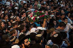 A wreath is passed at a joint funeral for the three Israeli teens at a cemetery in Modi'in near Jerusalem, on July 1, 2014. The three Israeli teens whose bodies were found Monday evening were brought to rest side by side on Tuesday at a joint funeral held in Modi'in near Jerusalem. Tens of thousands of people participated in the funeral, including Prime Minister Benjamin Netanyahu and President Shimon Peres, who eulogized the three, whose caskets were wrapped with Israeli flags. EXPA Pictures © 2014, PhotoCredit: EXPA/ Photoshot/ Li Rui<br /> <br /> *****ATTENTION - for AUT, SLO, CRO, SRB, BIH, MAZ only*****