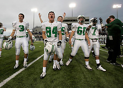 Brenham's Austin Wooten-Gonzales (84) celebrates the Cubs' 32-28 playoff victory over Angleton with teammates (l to r) Bryce Strauss, Chase Coghlan, Ty Jahns and Robert Felder, Saturday, November 28, 2009 at Woodforest Stadium in Shenandoah, TX.