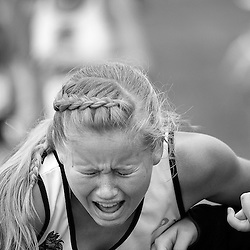 Madi Sommers, from Buhl High School winces after crossing the finish line of the Girls 3A Idaho State Cross Country Championship held at Eagle Island State Park. Sommers finished in 37th place with a time of 22:50.3. Saturday November 1, 2014