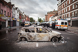 © Licensed to London News Pictures . 07/08/2011 . London , UK . A burned out police car on Tottenham High Street . Overnight rioting and looting in Tottenham , following a protest against the police shooting of Mark Duggan . Photo credit : Joel Goodman/LNP