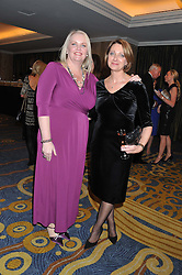 Left to right, JO WALKER and JANET SAUNDERS at the 20th CEW (UK) Achiever Awards 2012 - celebrating two decades of women, passion, beauty, held at the Hilton, park Lane, London on 16th October 2012.
